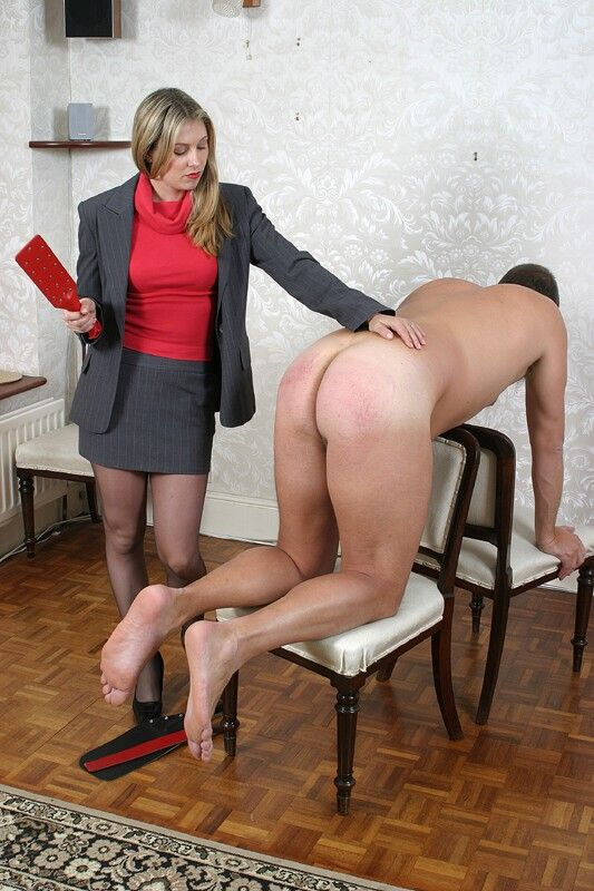 Husband is spanked in pantyhose